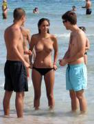 The most popular girl on the beach...I wonder why?