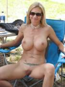 Milf shows shaved pussy otdoor