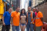 Katrina Jade posing with some workers making their work day a bit better
