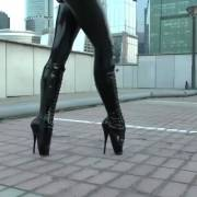 Walking in a catsuit and ballet boots