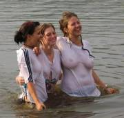 3 swimming in white shirts