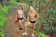 Two hot topless babes hiking in the woods