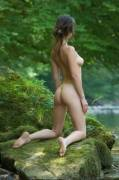 Surrounded by soft green she needs no clothes