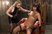 Bound to a chair, nipples clamped and stretched, and being caned