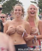 cute embarrassed girl flashing tits in public(gif)