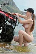 Woman in Hat Attempts to Wash Quad Bike with Seawater