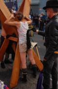 Petite exhibitionist goes topless, gets flogged, and has her crotch vibed at Folsom Street Fair 2011