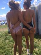 Two cheeky one-pieces at a festival
