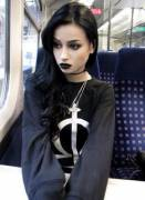 Lil' Goth Girl alone on the bus