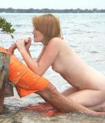 Redhead handjob at the lake