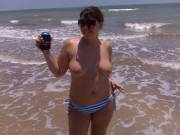 Posing topless at the beach