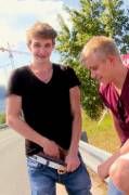 Guy shows his bro his big uncut cock on the side of the road [GIF]