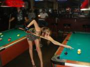 Wife at the bar, playing pool